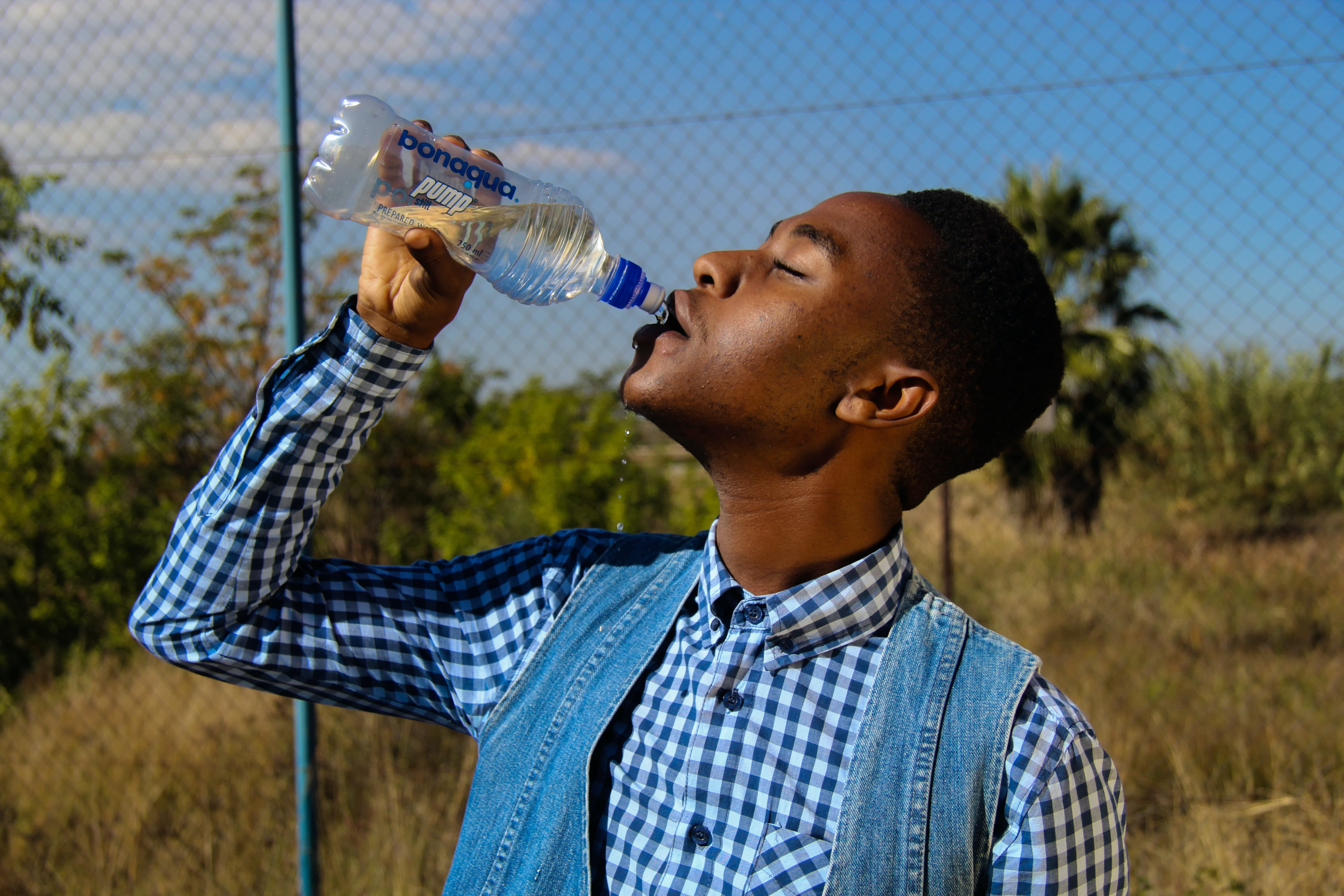photography-of-a-man-drinking-water-1126557